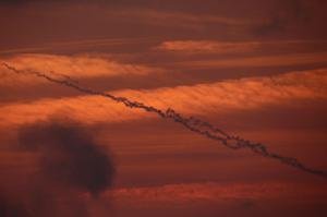 ISRAEL/GAZA BORDER - ISRAEL - NOVEMBER 19:  Smoke trails from a militant rocket cross the evening sky as they head into Israel on November 19, 2012 on Israel's border with the Gaza Strip. According to reports November 19, 2012, at least 90 Palestinians have been killed and more than 700 wounded during the Israeli offensive in the Gaza Strip.  (Photo by Christopher Furlong/Getty Images)