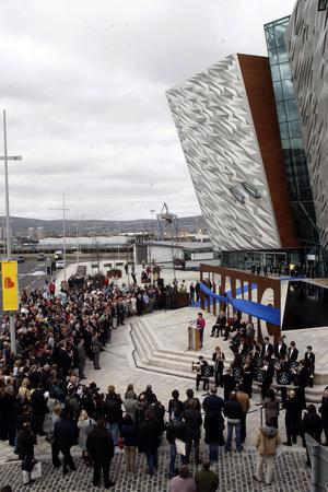 Crowds of tourists wait for the opening of the new Titanic Belfast tourism project