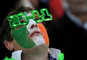 An Ireland fan in the stands during the IRB Rugby World Cup match at the Otago Stadium, Dunedin, New Zealand. PRESS ASSOCIATION Photo. Picture date: Sunday October 2, 2011. See PA story RUGBYU Ireland. Photo credit should read: Lynne Cameron/PA Wire. RESTRICTIONS Use subject to restrictions. Editorial reporting purposes only; no images to be used to simulate a moving image. Commercial including Book use only with prior written approval. Call +44 (0) 1158 447447 or see www.pressassociation.com/images/restrictions.