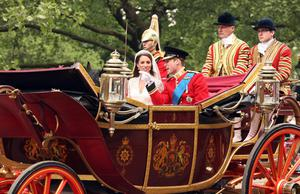 Prince William and his bride Kate make their way down The Mall in London in the procession to Buckingham Palace after the wedding ceremony. PRESS ASSOCIATION Photo. Picture date: Friday April 29, 2011. Photo credit should read: Chris Radburn/PA Wire