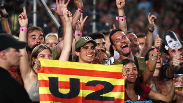 Fans go mad as U2 perform onstage on the first night of their 360 tour held at Camp Nou on June 30, 2009 in Barcelona, Spain
