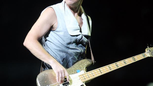 Adam Clayton of U2 performs onstage on the first night of their 360 tour held at Camp Nou on June 30, 2009 in Barcelona, Spain.