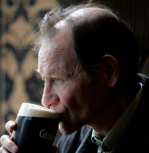 """Alex Higgins  pictured at a bar in Belfast where he spoke about his his  autobiography """"Alex Higgins  'My Story' from the eye of the Hurricane""""."""