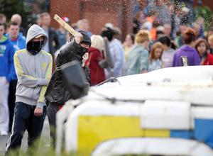 Press Eye - Belfast - Northern Ireland -   Sunday 2nd August  2012- Picture by Kelvin Boyes / Press Eye.Disturbance between Loyalists and Republicans at the Carlisle Circus area of north Belfast following a parade in the area.Police come under fire from loyalists