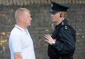 Ardoyne resident Eddie Copeland speaking with police last night - Ardoyne residents gather to protest about the recent rioting in the area