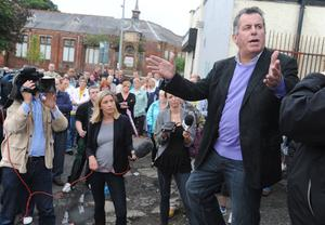 The SDLP's Alban Magennis speaks to residents in Ardoyne during a rally at Brompton Park to highlight opposition to those who have been  rioting in the area in recent nights