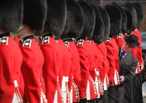 LONDON, ENGLAND - APRIL 21:  Master Tailor Lance Sergeant Matthew Else inspects the uniforms of  members of the Irish Guards during an inspection at Victoria Barracks on April 21, 2011 in London, England. The Irish Guards returned from active duty in Afghanistan at the beginning of April, and are now preparing for ceremonial duties. Prince William is the Colonel of the Regiment and the Irish Guards will be on duty at the Royal Wedding on April 29, 2011.  (Photo by Peter Macdiarmid/Getty Images) *** Local Caption *** Matthew Else;