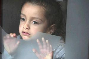 Frightened children are among the Romanian families forced to flee from racist attacks in south Belfast