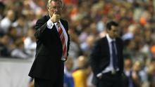 Sir Alex Ferguson the manager of Manchester United gives a thumbs up as Unai Emery the Valencia coach looks on during the UEFA Champions League Group C match between Valencia and Manchester United at the Mestalla Stadium on September 29, 2010 in Valencia, Spain