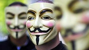 Activists of the organization 'Anonymous' hold masks in front of their faces on August 14, 2008 during a demonstration in Berlin.