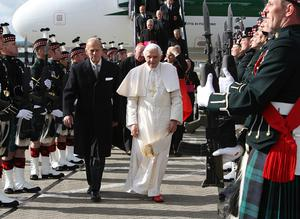 Pope Benedict XVI is met by the Duke of Edinburgh as he arrives in Scotland to begin the first papal state visit to the UK