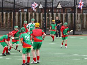 Pupils from St Paul's and St Kevin's from the Falls Road along with Edenbrook and Glenwood Primary Schools from the Shankill Road playing a game of hurling at the Norman Whiteside pitches in the Shankill area of Belfast