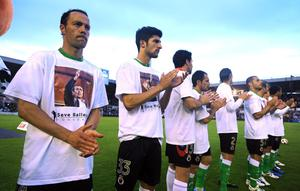 SANTANDER, SPAIN - MAY 10:   Osmar Barba (L) of Racing Santander applauds with teammates during a homage to the late Spanish golfing legend Seve Ballesteros before the La Liga match between Racing Santander and Atletico Madrid on May 10, 2011 in El Sardinero stadium in Santander near Ballesteros' home village of Pedrena, in Spain.  The funeral for the legendary Spanish golfer, who died at the age of 54 following a lengthy battle with cancer,  will be held tommorow in his home town of  Pedrena.  (Photo by Denis Doyle/Getty Images)