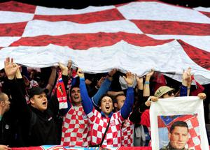 POZNAN, POLAND - JUNE 14:  Croatian fans show their support during the UEFA EURO 2012 group C match between Italy and Croatia at The Municipal Stadium on June 14, 2012 in Poznan, Poland.  (Photo by Jamie McDonald/Getty Images)