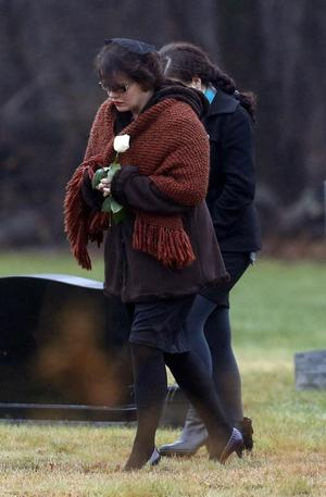 Veronique Pozner arrives at B'nai Israel Cemetery, Monday, Dec. 17, 2012, in Monroe, Conn., for burial services for her 6-year-old son Noah Pozner, who was killed Friday when Adam Lanza opened fire inside the Sandy Hook Elementary School in Newtown, killing 26 people, including 20 children, before taking his own life. (AP Photo/Julio Cortez)