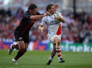 DUBLIN, IRELAND - APRIL 28:  Darren Cave of Ulster is tackled by Ross Ford of Edinburgh during the Heineken Cup semi final match between Ulster and Edinburgh at Aviva Stadium on April 28, 2012 in Dublin, Ireland.  (Photo by Warren Little/Getty Images)