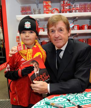 Liverpool legend Kenny Dalglish pictured today at the club's new  superstore opened at Castle Place.Ryan Rogers (7) from Belfast gets his book signed