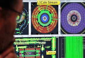 A European Center for Nuclear Research (CERN) scientist controls a computer screen showing traces on Atlas experiment of the first protons injected in the Large Hadron Collider (LHC) during its switch on operation at the Cern's press center on Wednesday, Sept. 10, 2008 near Geneva, Switzerland. Scientists fired a first beam of protons around a 27-kilometer (17 mile) tunnel housing the Large Hadron Collider (LHC). They hope to recreate conditions just after the so-called Big Bang. The international group of scientists plan to smash particles together to create, on a small-scale, re-enactments of the Big Bang. (AP Photo/Fabrice Coffrini, Pool)