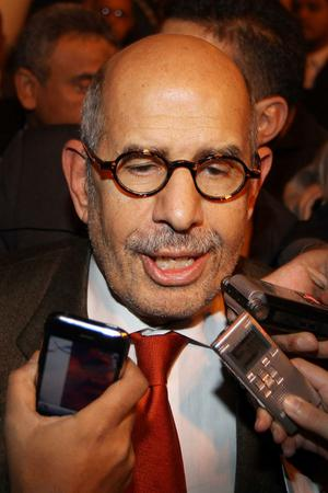 CAIRO, EGYPT - JANUARY 27: Egyptian opposition leader Mohamed ElBaradei is surrounded by reporters as he arrives at Cairo airport on January 27, 2011 in Cairo, Egypt. Mr ElBaradei has vowed to join anti government protesters in Cairo tomorrow.  (Photo by Peter Macdiarmid/Getty Images)