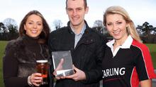 Coleraine boss Oran Kearney collects December's Manager of the Month award from Carling girls Denise Catney and Catherine Jennings after guiding the Bannsiders to 10 games unbeaten