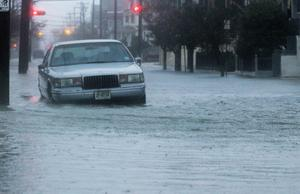 ATLANTIC CITY, NJ - OCTOBER 29:  A car sits in a flooded street near the ocean ahead of Hurricane Sandy on October 29, 2012 in Atlantic City, New Jersey.  Governor Chris ChristieÄôs emergency declaration is shutting down the cityÄôs casinos and 30,000 residents were ordered to evacuate. (Photo by Mario Tama/Getty Images