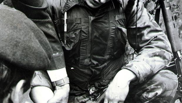 A soldier recieves first aid after being injured by debris after a car bomb exploded on the Crumlin Road. 29/05/72