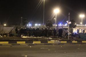Bahrani riot policemen are seen after attacking demonstrators camping at the Pearl roundabout in Manama.