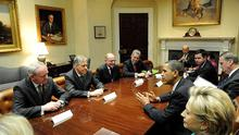 President Barack Obama talking to First Minister Peter Robinson (second left) and Deputy First Minister Martin McGuinness (left) during their meeting in the Roosevelt Room, White House, Washington. Also included are Secretary of State Hillary Clinton and vice President of the United States, Joe Biden