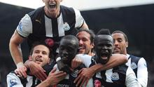 Newcastle United's Papiss Cisse (front second from left) celebrates scoring his second goal of the game with his team-mates during the Barclays Premier League match at the Sports Direct Arena, Newcastle