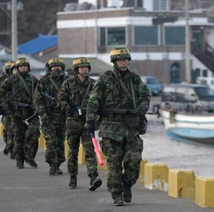 South Korean Marines patrol along the shore of Yeonpyeong Island (AP)