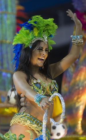 Lingerie model Larissa Riquelme of Paraguay waves from the top of a Vila Maria samba school float during carnival celebrations in Sao Paulo, Brazil, Sunday March 6, 2011. (AP Photo/Andre Penner)
