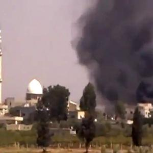 This image made from amateur video purports to show smoke from intense shelling in the Tel Chehab area of Daraa, Syria.(AP Photo/Shaam News Network SNN)