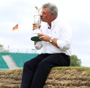 Darren Clarke with the Claret Jug on the 18th green following his victory in The 140th Open Championship at Royal St George's. 2011