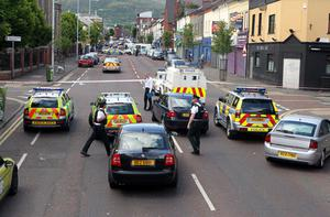 Police cordon off the scene of yesterday's fatal shooting on the Shankill Road