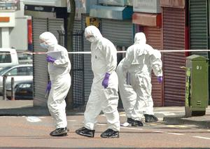 A man, named locally as Bobby Moffett , was shot dead on the Shankill Road in Belfast shortly after 1.00 pm yesterday in front of a bus-load of passengers and shoppers
