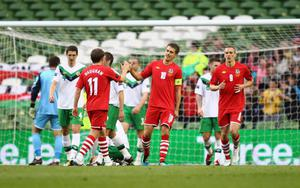 DUBLIN, IRELAND - MAY 27:  Aaron Ramsey of Wales is congratulated by team mate David Vaughan of Wales after the openning goal during the Carling Nations Cup match between Northern Ireland and Wales at the Aviva Stadium on May 27, 2011 in Dublin, Ireland.  (Photo by Julian Finney/Getty Images)