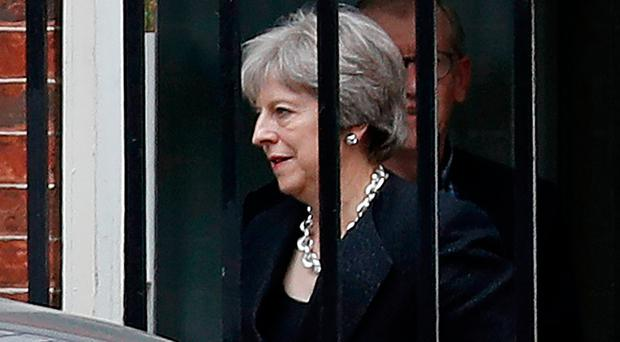 Prime Minister Theresa May leaves after the meeting