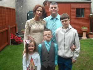 Missing father Stephen McCloskey with his partner Sinead and their three children