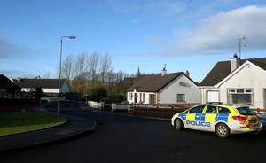 Police and forensic officers search the nearby area where the attack took place