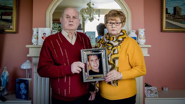 Breege and Stephen Quinn with a picture of their son Paul Quinn
