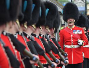 The Irish Guards form a guard of honour