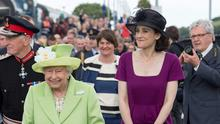The Queen with Northern Ireland Secretary Theresa Villiers (right) and First Minister Arlene Foster as she arrives at Bellarena railway station yesterday