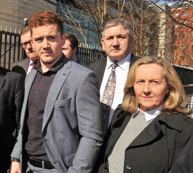 Paddy Jackson walks free from court yesterday with his mother and family by his side
