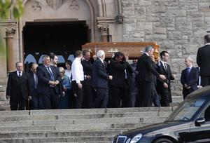 Mourners carry Feargal Magennis's coffin from St Patrick's Church in Downpatrick yesterday