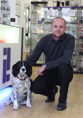 Owner Peter Dickson with his springer Pepsi in the shop