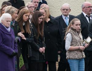 Friends and family mourn at the funeral yesterday of Donegal farmer Seamus Hegarty, who was buried in the graveyard adjoining St Patrick's Church in Murlog