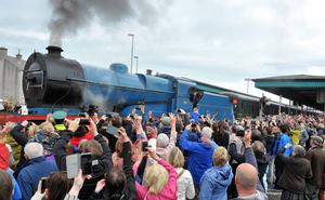 Crowds wave as they depart Coleraine