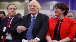 Boris Johnson with DUP's Nigel Dodds and Arlene Foster at the party's conference last year