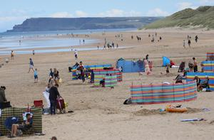 Holidaymakers on the beach at Portrush