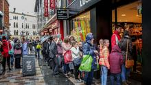 Shoppers queuing outside Lush in Belfast city centre yesterday